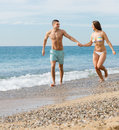Newly married couple at the beach happy resting in honeymoon Stock Photography
