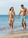 Newly married couple at the beach happy smiling having fun in honeymoon Royalty Free Stock Photo