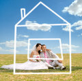 Newly married couple beautiful on nature in park sit on lawn and dreaming about house Royalty Free Stock Photo
