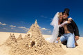 Newly-married couple enjoying on the beach Royalty Free Stock Images