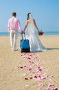 Newly married couple happy to go on a honeymoon on sea Royalty Free Stock Photography