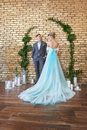 Newly married couple, loving couple before the wedding. Man and woman loving each other. Bride in the turquoise dress and groom Royalty Free Stock Photo