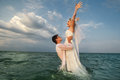 Newly-married couple swimming in sea Royalty Free Stock Photo