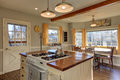 Newly renovated Kitchen and breakfast nook with wood beams on c