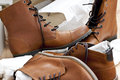 Newly unpacked good quality brown leather boots shoes all laces ready autumn season Stock Photos