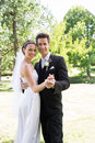 Newly wed couple dancing in garden portrait of happy young together Royalty Free Stock Image