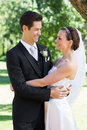 Newly wed couple embracing each other in garden affectionate Royalty Free Stock Images