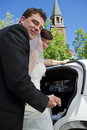 Newly wed couple enter car portrait of newlywed getting in the Stock Photography