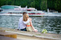Newly wed couple sitting on the seine embankment young in paris Stock Image