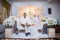 Newly wedded couple posing malay in an indoor portraiture Royalty Free Stock Photography