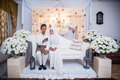Newly wedded couple posing malay in an indoor portraiture Royalty Free Stock Image