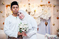 Newly wedded couple posing malay in an indoor portraiture Royalty Free Stock Photos