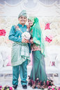 Newly wedded couple posing malay in an indoor portraiture Stock Images