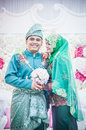 Newly wedded couple posing malay in an indoor portraiture Royalty Free Stock Photo