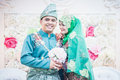 Newly wedded couple posing malay in an indoor portraiture Royalty Free Stock Images