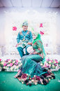 Newly wedded couple posing malay in an indoor portraiture Stock Image