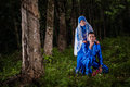 Newly wedded couple posing malay in an outdoor portraiture Royalty Free Stock Image