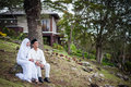 Newly wedded couple posing malay in an outdoor portraiture Stock Image