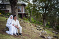 Newly wedded couple posing malay in an outdoor portraiture Royalty Free Stock Photography