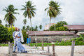 Newly wedded couple posing malay in an outdoor portraiture Royalty Free Stock Images