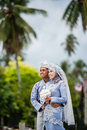 Newly wedded couple posing malay in an outdoor portraiture Royalty Free Stock Photos