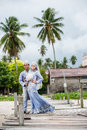Newly wedded couple posing malay in an outdoor portraiture Stock Photo