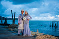 Newly wedded couple posing malay in an outdoor portraiture Royalty Free Stock Photo