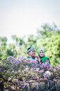 Newly wedded couple posing malay in an outdoor portraiture Stock Photos