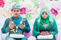 Newly wedded couple praying malay posing in an indoor portraiture Royalty Free Stock Photo
