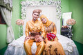 Newly wedded couple resting on bed malay in their room Royalty Free Stock Photo