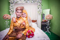 Newly wedded couple resting on bed malay in their room Stock Photography