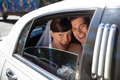Newly weds laughing in car Stock Photos