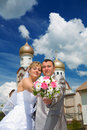 Newlywed couple on a background of a church Royalty Free Stock Image