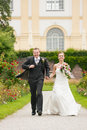 Newlywed couple - bride and groom - in a park runn Royalty Free Stock Photography