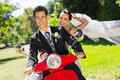 Newlywed couple enjoying scooter ride portrait of a Stock Image