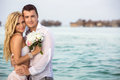 Newlywed couple happy standing in water maldives islands Stock Photo