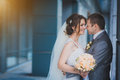 Newlyweds against a blue modern building happy background Royalty Free Stock Photography