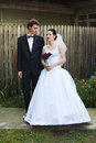 Newlyweds in courtyard young dressed ceremony clothes Stock Images