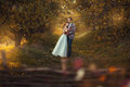 Newlyweds are embracing in the garden autumn among trees Royalty Free Stock Images