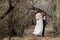 Newlyweds in fun dance laughing white lesbian couple dancing a forest Royalty Free Stock Image