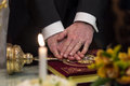 Newlyweds hands vows on the bible at wedding ceremony Stock Photos