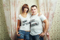 Newlyweds hugging happy t shirts shot in the studio Royalty Free Stock Photos