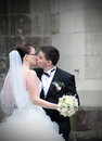 Newlyweds kiss loving couple outdoors Stock Photo