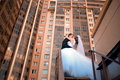 Newlyweds kiss on the stairs place Stock Photography