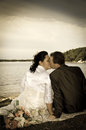 Newlyweds kissing in retro style outdoor portrait autumn scenery Stock Photo