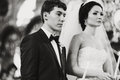 Newlyweds look musing during a ceremony in the church Royalty Free Stock Photo