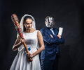 Newlyweds serial murderers, black background Royalty Free Stock Photo