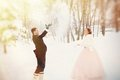 Newlyweds in the winter park Stock Photos