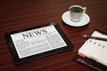 News on digital tablet pc shows latest screen which lying work place Royalty Free Stock Photo