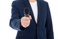 News reporter journalist interviews a person holding up the micr microphone isolated on white Stock Photo